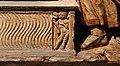 Vecchietta e neroccio di bartolomeo de' landi, seppellimento della vergine e assunta, 1477-82 (lucca, villa guinigi) 07 genio funerario su sarcofago strigilato.jpg