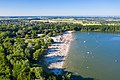 View from the west of the sand beach and swimming area of the lake Otto-Maigler-See in Hürth, Germany (48331385417).jpg