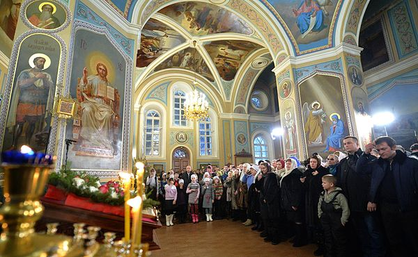 Vladimir Putin in Pokrova Church (Turginovo) 04.jpg