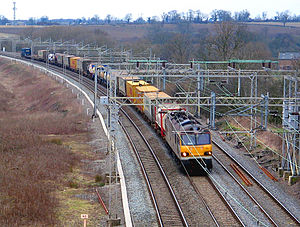 Rail freight transport - A Class 92 hauled container freight train on the West Coast Main Line, United Kingdom