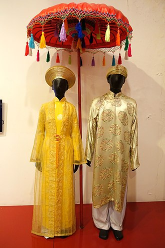 Traditional Vietnamese wedding - A typical wedding gown for both the bride and groom. Nowadays, some gowns take on Western influences, such as a long train in the back or wearing colors besides the typical blue and red palette.