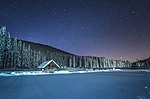 Winter cottage at night at Pokljuka.jpg
