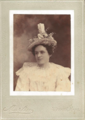 Woman in hat by Martin of Ottawa Kansas.png