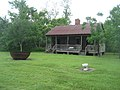 WoodlandPlaqueminesSlaveCabinTerlit.JPG