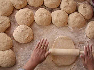 Baker - A rolling pin is used to work dough.