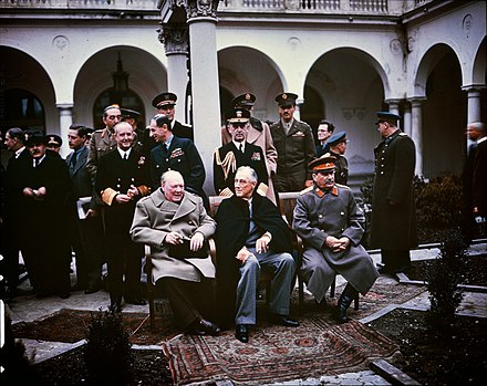 Poland's fate was heavily discussed at the Yalta Conference in February 1945. Joseph Stalin, whose Red Army occupied the entire country, presented several alternatives which granted Poland industrialized territories in the west whilst the Red Army simultaneously permanently annexed Polish territories in the east, resulting in Poland losing over 20% of its pre-war borders. Stalin then imposed upon Poland a Soviet-backed puppet communist government following the war, forcibly bringing the nation into the Soviet sphere of influence. Yalta Conference 1945 Churchill, Stalin, Roosevelt.jpg