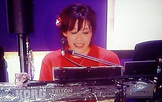 Keisuke Kuwata - Yuko Hara on keyboards during the Southern All Stars' 30th Anniversary concert