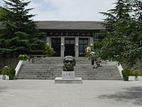 Zhoukoudian Peking Man Site - the Museum (taken in July 2004). At the centre: what Peking Man looked like.