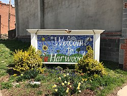 Harwood neighborhood welcome sign at Barclay and East 25th Streets