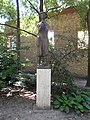 'Flute-playing girl' or 'Girl with a flute' sculpture by the Franciscan Church of St Clare, a modern bronze statue (with pedestal). - Margaret Island, Budapest.JPG
