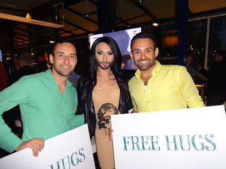 The free-huggers Thyago Ohana (right) and Alejandro Sosa (left) with Conchita Wurst (middle) as the 'Free Hugs Vienna' group supported the Tolerance Campaign leading to Conchita's Eurovision Song Contest 2014 Victory 'Free Hugs Vienna' supporting Conchita Wurst's Tolerance Campaign.JPG