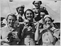 (Six smiling women in nurses' uniforms, each with a camera) (Frank Hurley) (26544181748).jpg