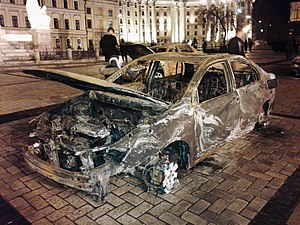 January 2015 Mariupol rocket attack - A charred civilian vehicle from Mariupol after the attack. Exhibition in Kiev.
