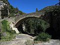 007 Pont del Rossinyol, cara sud, amb la roca Gironella al fons.JPG