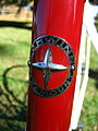 1938 Schwinn head badge (2958739400).jpg