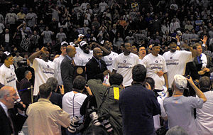 Georgetown Hoyas men's basketball - The team being presented with the trophy for East Regional Champions in the NCAA Tournament