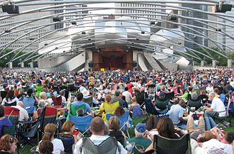 Millennium Park - Concertgoers listen to Beethoven's Ninth Symphony at the Jay Pritzker Pavilion, the centerpiece of Millennium Park.