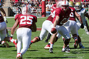 Tyler Gaffney - Gaffney receiving a handoff from Kevin Hogan in 2013.