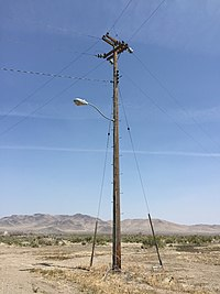 2015-04-20 13 14 28 Utility pole and street light along Morrison Avenue in Golconda, Nevada.jpg