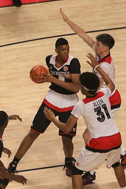 20160330 MCDAAG Tony Bradley Jr. attacks T. J. Leaf and Jarrett Allen (1).jpg