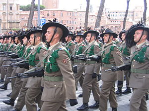 1st Bersaglieri Regiment - Bersaglieri of the Garibaldi Bersaglieri Brigade on parade in Rome on 2 June 2007. On the soldiers' left arm the Brigade's emblem could be seen.