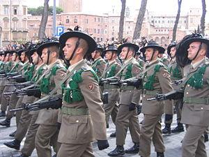 1st Bersaglieri Regiment - Bersaglieri of the Garibaldi Bersaglieri Brigade on parade in Rome on 2 June 2007. On the soldiers' left arm the Brigade's emblem could be seen.