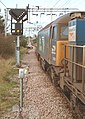 57 310 & 57 303 bring the Stowmarket-Clacton-Stowmarket RHTT working through Hythe station to a stop at Eastgates East Junction, before proceeding over the triangle towards Colchester North . Saturday 25th Oct 2014 - 15003834184.jpg