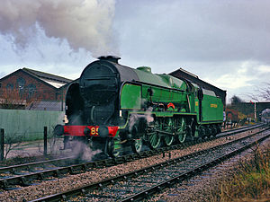 Carnforth MPD - Southern Railway Maunsell 4-6-0 ''Lord Nelson'' Class No.850 LORD NELSON passes the former Midland Railway roundhouse, running light engine from Steamtown to Hellifield, 27 November 1982