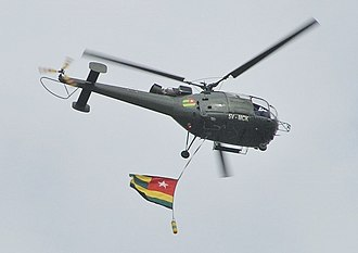 Togolese Armed Forces - An Alouette III with the national flag beneath
