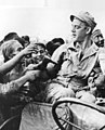 A-dutch-soldier-handing-out-clothes-to-civilians-in-Indonesia-391852457081 (cropped).jpg