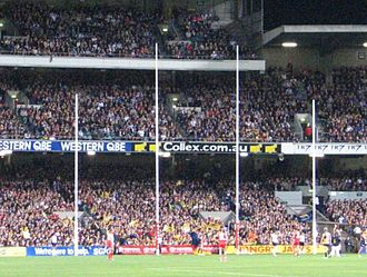 Laws of Australian rules football - Australian rules football goal posts – the two tall central posts are the goal posts, and the two shorter outer posts are the behind posts.