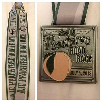 Peachtree Road Race - The 2013 finisher's medal, available for purchase as an additional option at registration. The coveted Peachtree T-shirt is provided to all participants who cross the finish line.