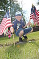 A Cub Scout, with Troop 319, places an American flag on the gravesite of a U.S. Soldier who served in the Spanish-American War at Calvary Cemetery in Grand Forks, N.D., May 24, 2013 130524-F-JB669-040.jpg