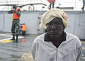 A Ugandan service member, left, guards a simulated detainee aboard a target vessel during exercise Cutlass Express 2013 in the Gulf of Tadjoura off the coast of Djibouti Nov. 14, 2013 131114-F-NJ596-141.jpg