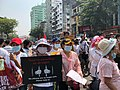 A girl with a protest sign - Yangon 1.jpg