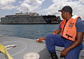 A member of the Barbados Defense Force looks out at high-speed vessel Swift (HSV-2) during a small boat operations subject matter expert exchange in Bridgetown, Barbados, Aug. 24, 2010 100824-N-GH121-057.jpg