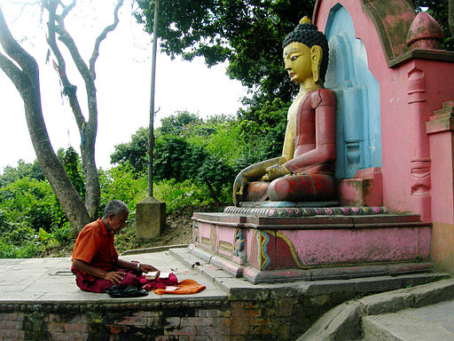 A praying Nepalese, Buddhist culture religion rites rituals sights