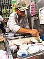 A street vendor making bubble tea in Tan Uyen District, Binh Duong Province, Vietnam (02).jpg