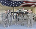 A team of female U.S. Service members hoist another female Service member on a litter at the Warrior's Way entrance at Craig Joint Theater Hospital at Bagram Airfield in Parwan province, Afghanistan, March 18 140318-F-BJ707-042.jpg