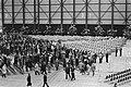 Aanwezigen verlaten de hal aan het einde van de dienst, Bestanddeelnr 929-1125.jpg