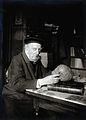 Adrien de Mortillet, holding a skull. Photograph. Wellcome V0028760.jpg