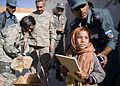 Afghan Police Give School Supplies to Kandahar Children DVIDS344799.jpg