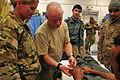 Afghan policeman helped by SFAT, FST 121213-A-BF245-305.jpg