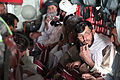 Afghan residents sit in a U.S. Air Force C-130 Hercules aircraft waiting for it to take off for Amman, Jordan, as part of the Voices of Moderate Islam (VOMI) program Aug 100825-A-UH396-144.jpg
