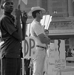 African American and white supporters of the Mississippi Freedom Democratic Party holding signs in front of the convention hall at the 1964 Democratic National Convention, Atlantic City, New Jersey (cropped2).jpg