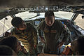 Airmen with the Royal Brunei Air Force listen as U.S. Navy Lt. j.g. Matt Barrett, center, with Patrol Squadron (VP) 26, describes the cockpit of a P-3C Orion aircraft during Cooperation Afloat Readiness 131114-N-KL795-298.jpg