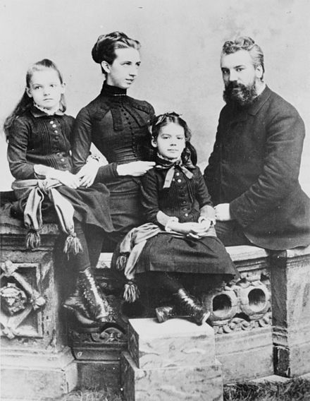 Alexander Graham Bell, his wife Mabel Gardiner Hubbard, and their daughters Elsie (left) and Marian ca. 1885 Alexander Graham Bell and family.jpg