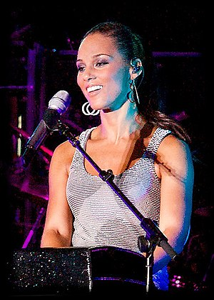"Kaleidoscope Dream - Alicia Keys (pictured in 2008) co-wrote and sang on ""Where's the Fun in Forever""."