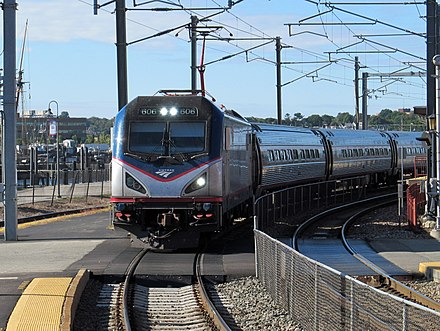 A typical Northeast Regional with an ACS-64 locomotive and Amfleet passenger cars at New London Union Station Amtrak 606 entering New London Union Station, September 2014.JPG
