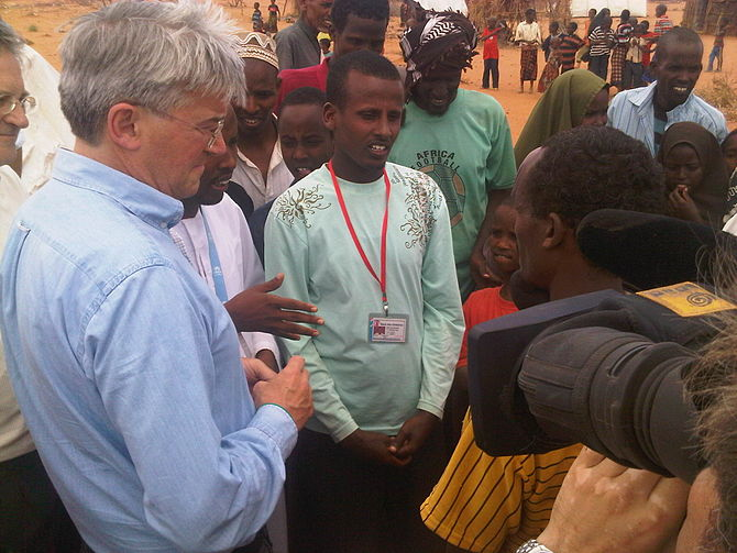 Andrew Mitchell talks to refugees from Somalia...